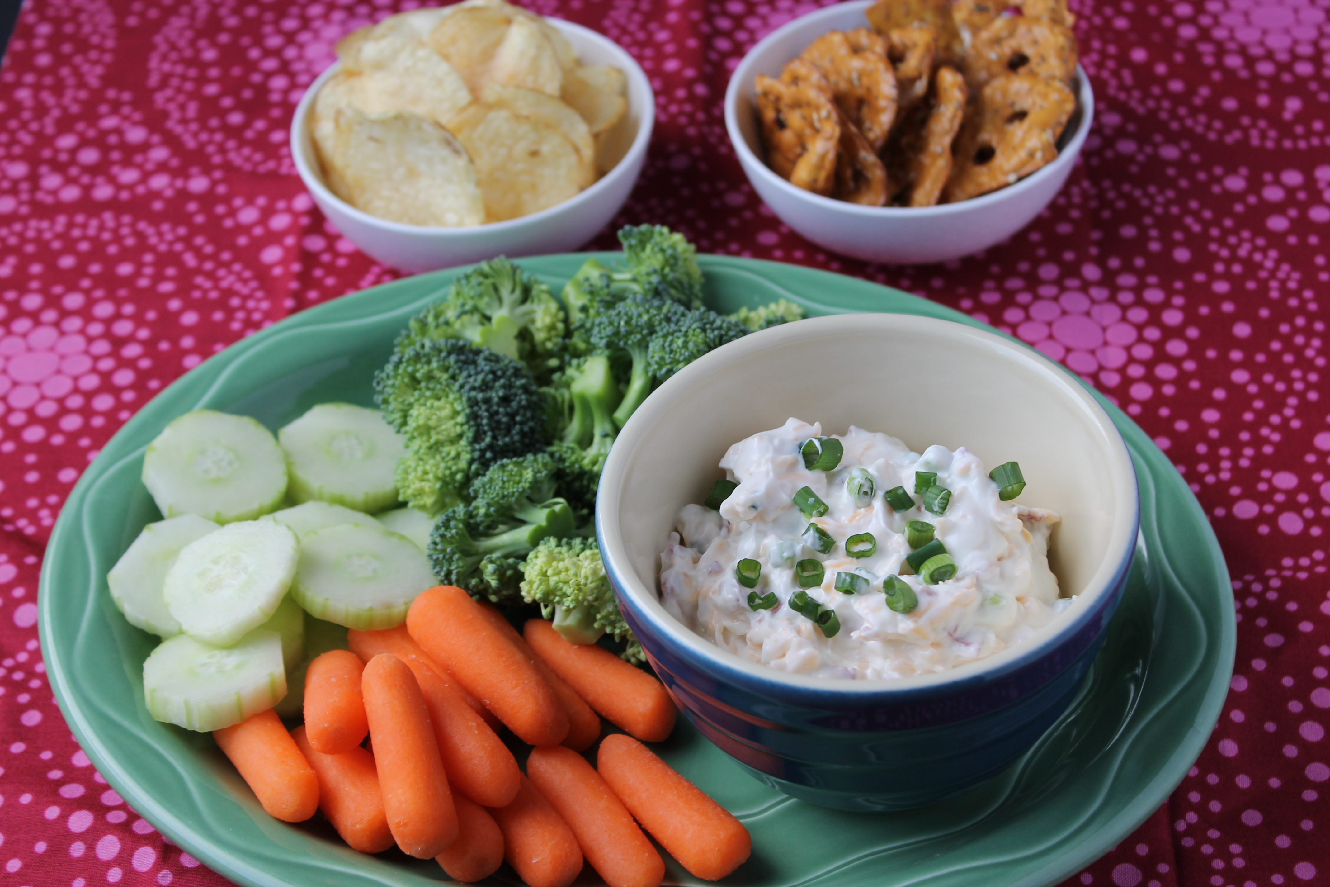 Baked Potato Dip with veggies, chips, and pretzels